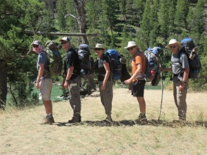 That's me in the middle with husband and three of four sons on backpacking trek in Yellowstone National Park.